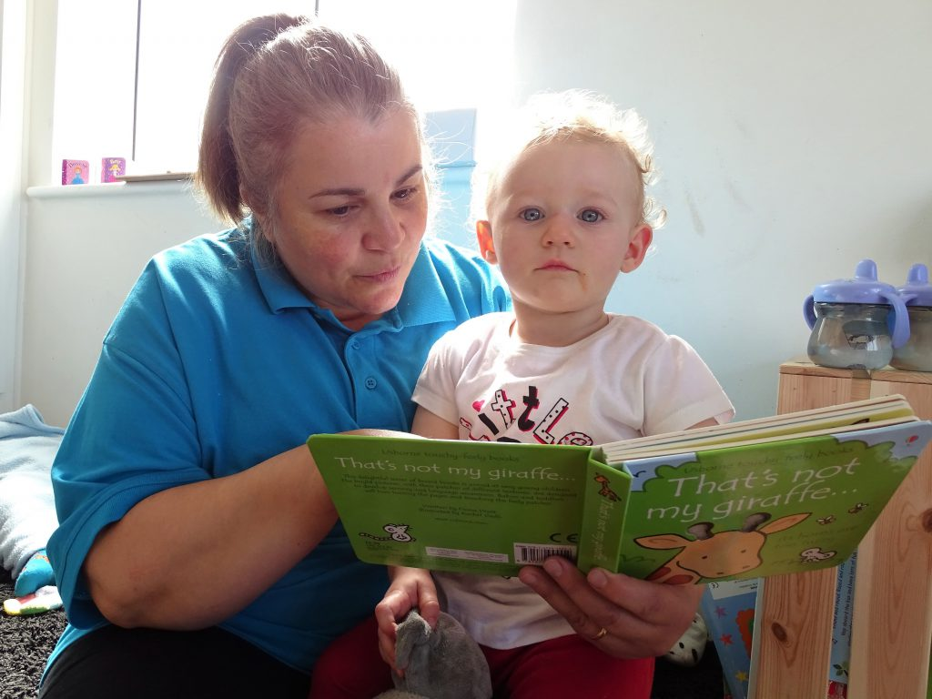 Anna Reading to Child